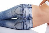 stock photo of bare butt  - Fit female butt in blue jeans - JPG