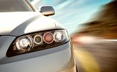 stock photo of car ride  - A car driving on a motorway at high speeds overtaking other cars - JPG