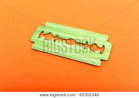 Razor blade on color background