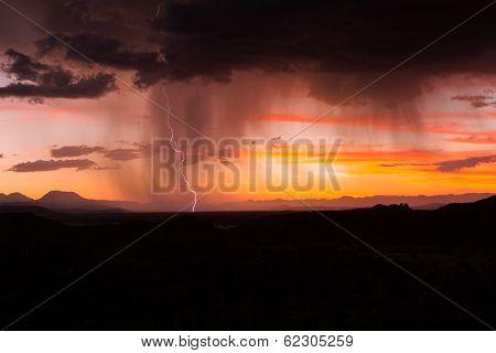 Thunderstorm And Lightning Strike At Sunset