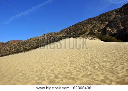 Mountains and desert sand