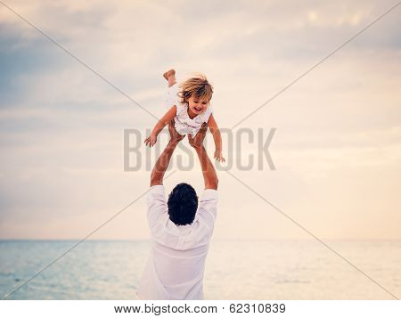 Healthy Father and Daughter Playing Together at the Beach at Sunset. Happy Fun Smiling Lifestyle