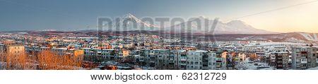 Petropavlovsk-kamchatsky Cityscape. Sunrise Over Koryaksky And Avachinsky Volcanoes. Far East, Russi