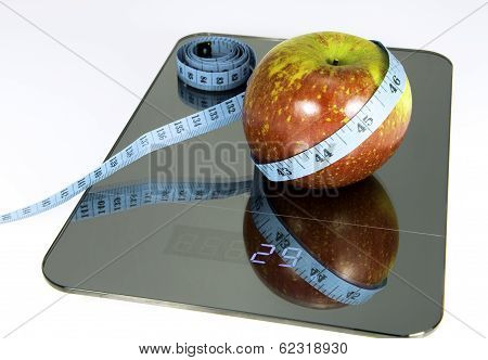 Apple on the scale.