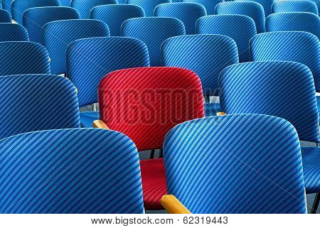 Red Seat Standing Out