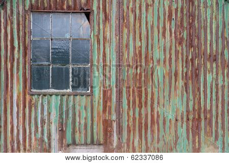 External Rusty Corrugated Iron Wall Of A Building