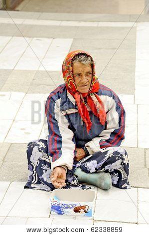 A beggar woman begging on a pedestrian street in Prilep, Macedonia.