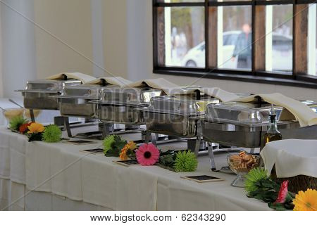 Long table with serving warmers