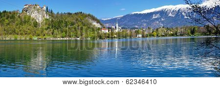 Crystal Clear Waters And Snow-capped Mountains At Lake Bled, Slovenia