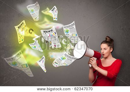 Cute girl yelling into loudspeaker and newspapers fly out