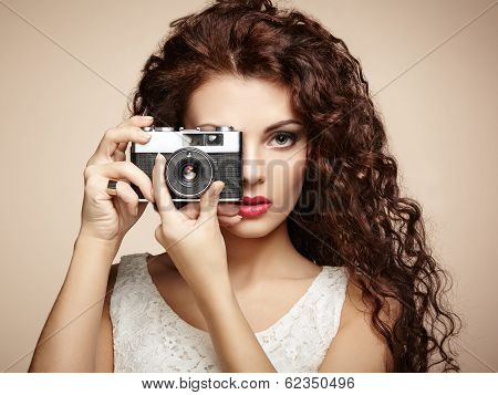 Portrait Of Beautiful Woman With The Camera. Girl Photographer