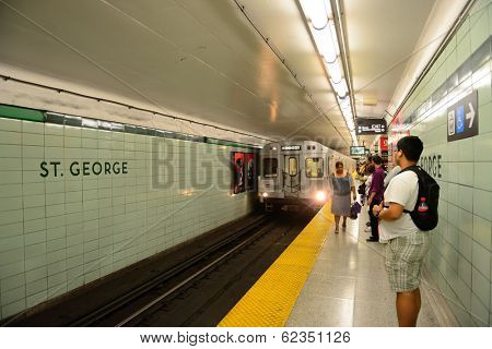 TORONTO, CANADA - JULY 3: Subway with passengers on July 3 in Toronto, Canada. 2012. Operated by Government of Ontario in Great Toronto, it carries over 217,000 passengers weekday and 57 M annually.