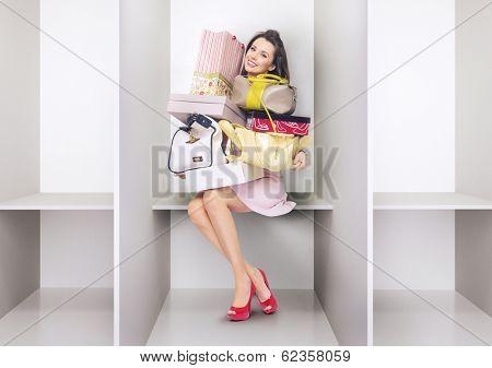 Young woman sitting in a changing room