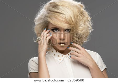 Beauty Portrait Woman With Golden Makeup And Blonde Hair