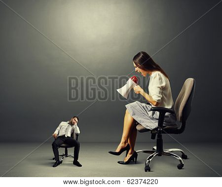 screaming businesswoman and tired small businessman over dark background