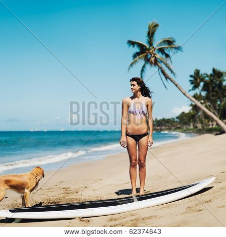 Artistic Image of Surfer Girl on the Beach, Shallow Depth of Field Artsy Vintage Color.
