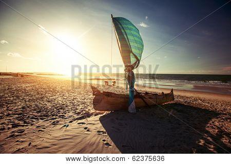 Traditional Malagasy boat on sandy beach. Morondava, Madagascar