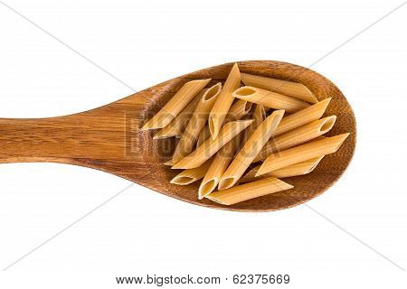 Wholemeal Penne Pasta On A Wooden Spoon