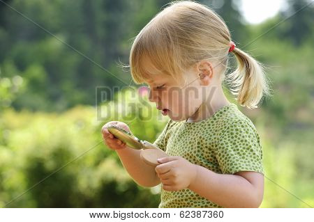young girl with powder compact