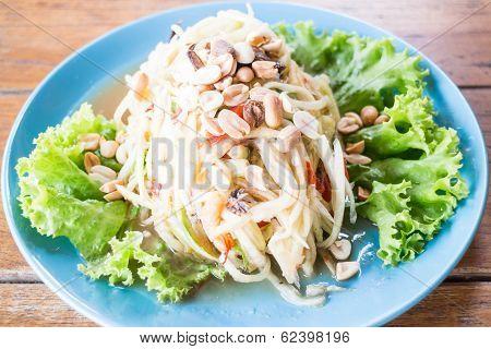 Spicy Papaya Salad Serving On Wood Table