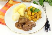 foto of rutabaga  - Game stew with turnips vegetables and potatoes  - JPG