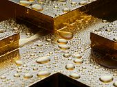 Water Drops On Gold