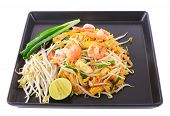 stock photo of shrimp  - Thai food Pad thai Stir fry noodles with shrimp on black plate - JPG