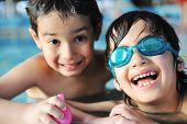 Two children having fun happy time on swimming pool