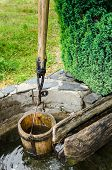 picture of shadoof  - Old vintage well with a bucket and leverage in Maramures Romania - JPG