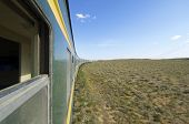 stock photo of trans  - Trans Mongolian Train across the mongolian steppe - JPG