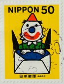 JAPAN - CIRCA 1999: A stamp printed by Japan, shows Clown with yellow hat, jumping up out of envelop