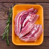 stock photo of veal meat  - Raw meat for barbecue with fresh vegetables wooden surface - JPG