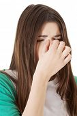 foto of sinus  - Young beautiful woman with sinus pressure - JPG