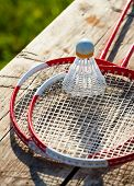 picture of shuttlecock  - Badminton racquets with shuttlecock on a bench - JPG