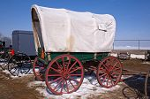 stock photo of covered wagon  - Covered wagon and buggies for sale at the annual spring mud sale - JPG