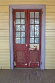 stock photo of creole  - an old worn door on a creole plantation house