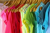 stock photo of casual wear  - Colorful clothes hanging in wardrobe - JPG