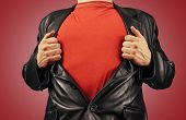 foto of open shirt breast showing  - Unrecognizable man opens suit showing red t - JPG