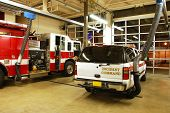 picture of firehouse  - Modern fire station at night with fire apparatus - JPG