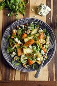 stock photo of rocket salad  - Salad made of roasted vegetables rocket Stilton and walnuts - JPG