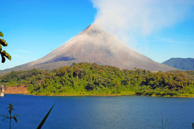 stock photo of biodiversity  - The active Arenal Volcano in Costa Rica - JPG