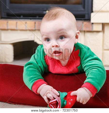 Adorable Baby Boy With Christmas Decoration.