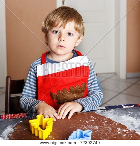 Adorable Boy Baking Ginger Bread Cookies For Christmas