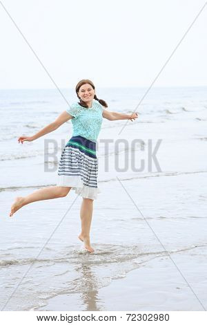 Young Happy Woman Having Fun And Dancing On The Beach Of North Sea