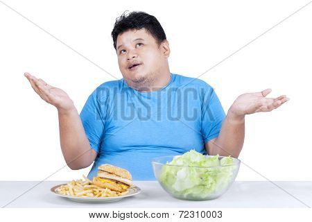 Obese Man With Two Kinds Of Food 1