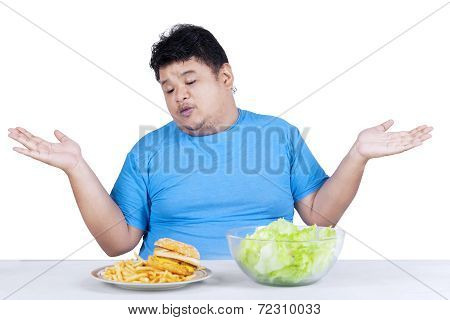 Obese Man With Two Kinds Of Food