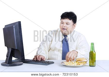Obesity Businessman Working While Eating