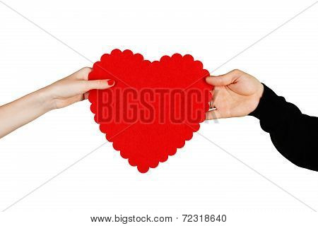 Couple In Love Holding A Red Heart In Their Hands
