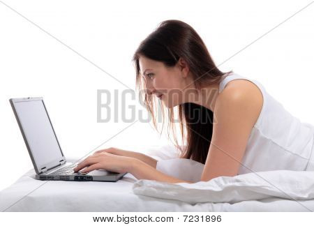 Woman With Noetbook Computer In Bed