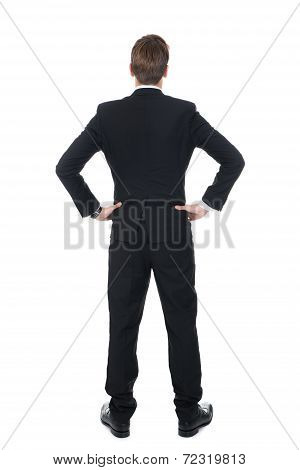 Confident Businessman Standing With Hands On Hips
